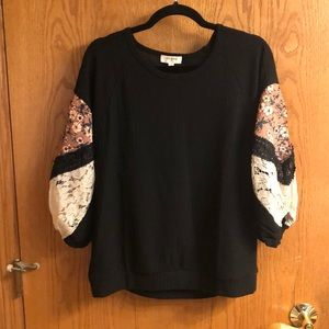 Black waffle knit top with blouson sleeves